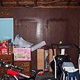 Before - Left Wall From Inside Garage, View of Peg Wall and Treadmill