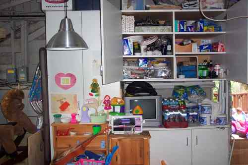 BEFORE - cabinets blocked by large toys